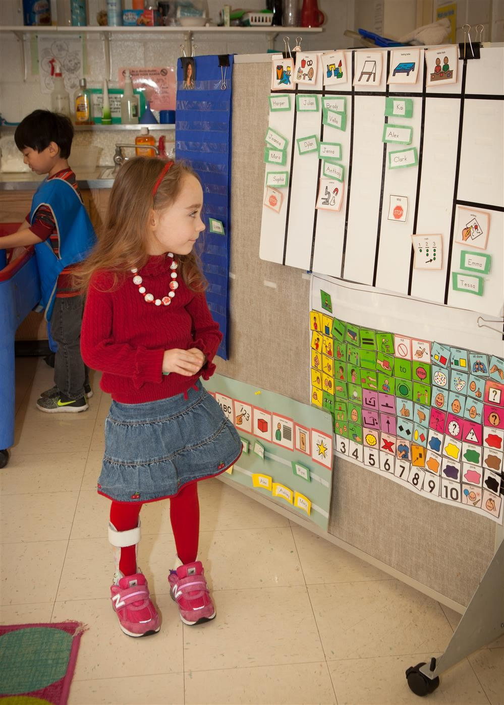 little girl looking at board